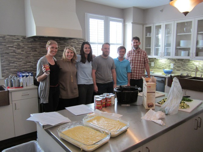 The team pausing for a quick photo during meal prep.