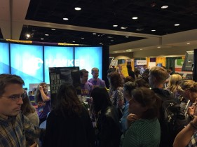 Attendees enter the exhibit hall.