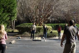 Action shot of corn hole.
