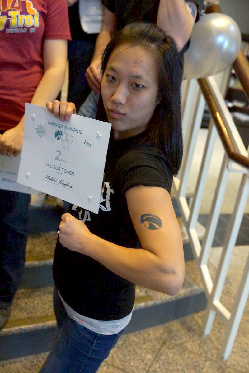 Nikki shows off the Hawkes tattoo.