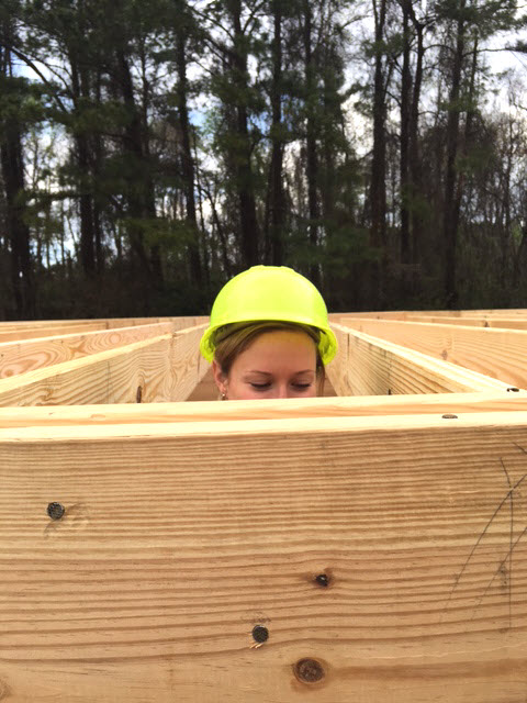 Laura peeks at the wooden boards.