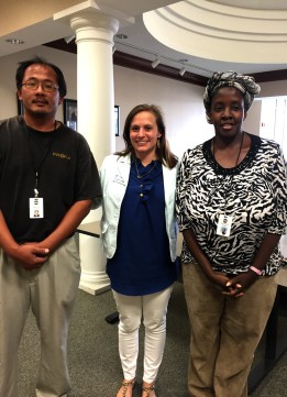 Three individuals (two math instructors and a Hawkes training representative) pose for a picture during a campus visit.
