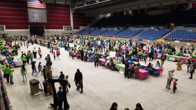 An view of all the booths shows dozens of community members stopping by.