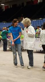 A student speaks with an instructor dressed as Albert Einstein.
